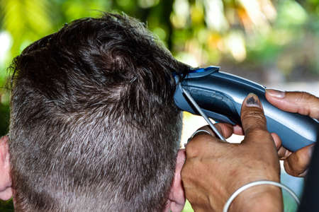 barber: man getting haircut by hairdresser. Stock Photo