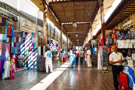 Dubai, United Arab Emirates -November 6, 2015: Shops and vendors in the ancient covered textile souq Bur Dubai in the old city centre