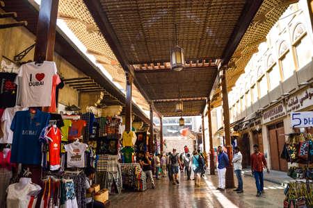 Dubai, United Arab Emirates -November 6, 2015: Shops and vendors in the ancient covered textile souq Bur Dubai in the old city centre