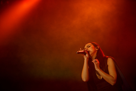 KYIV, UKRAINE - DECEMBER 5: The famous Ukrainian singer Jamala sings with eyes closed presenting her new album Podykh (Breath), 5 December 2016, International Center of Culture and Arts (October Palace)