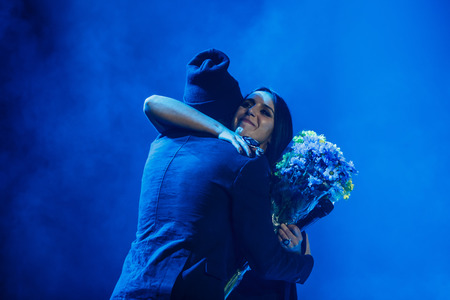 executor: KYIV, UKRAINE - DECEMBER 5: The famous Ukrainian singer Jamala takes a flowers from the fan presenting her new album Podykh (Breath), 5 December 2016, International Center of Culture and Arts (October Palace)