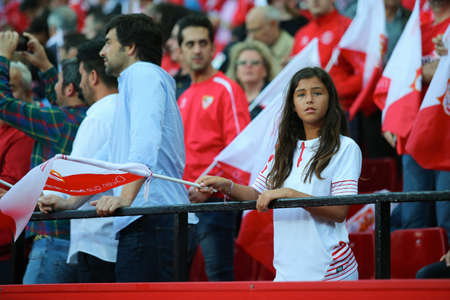 SEVILLA, SPAIN - MAY 5: Sevilla FC girl-fan stays on the stands with a flag during the UEFA Europa League second leg semi-finals match between FC Shakhtar Donetsk vs Sevilla FC, 5 May 2016, Ramon Sanchez Pizjuan, Spain