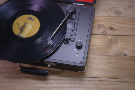 Record player stylus on old wooden