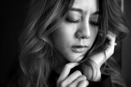 Beautiful young woman lonely, Close up her eyes and cry about the past depressed, In black and white concept person fear sadness. Stock Photo
