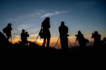 silhouette of photographer taking picture of landscape during sunrise Reklamní fotografie