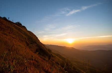 gold color: Beautiful landscape sunrise nature background Mountains and sky gold color