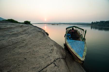 Longtail boat, Berth at sand Sam Pan Bok Grand Canyon in Maekhong river, Northeast of Thailand