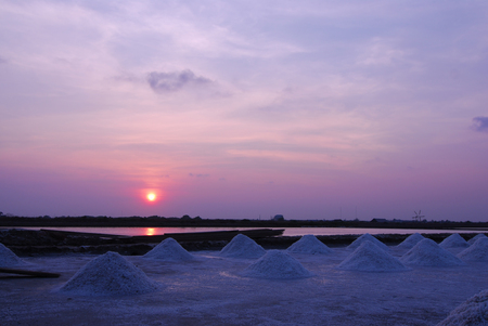 Beautiful sunset salt farming (Naklua) in the coastal, Phetchaburi provinces of Thailand Stock Photo