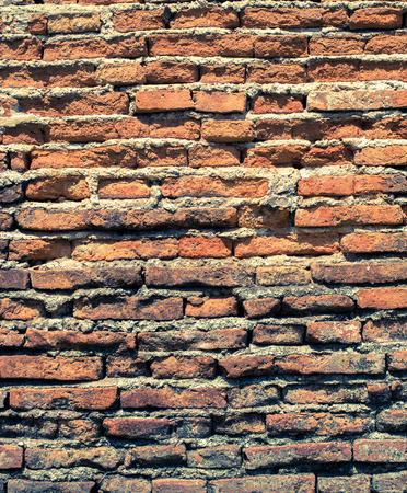 Old brick wall texture in a background image Stock Photo