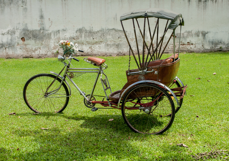 three wheeler: Thailand rickshaw three - wheeler Tricycle bicycle taxi for local people and tourists. old classic traditional asian tricycle