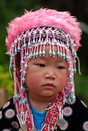 CHIANG MAI, THAILAND - OCTOBER 25 : Portrait of unidentified Akha hill tribe children with traditional at Wat Phratat Doi Suthep on OCTOBER 25, 2009 in Chiang Mai, Thailand. Editorial