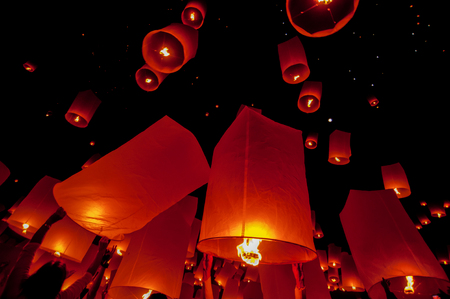 newyear night: Floating lantern in Yee Peng festival (Loy Krathong), Buddhist floating lanterns to the Buddha in Sansai district  in CHIANG MAI THAILAND