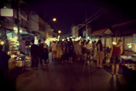 music background: Night Festival Event Party on street with People Blurred Background, vintage tone