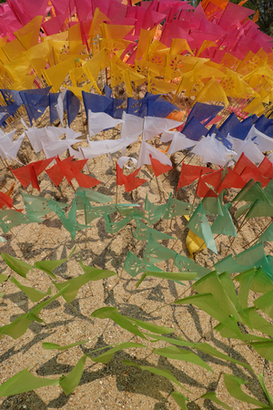 Flag on a heap of sand in Songkran festival at Thailand