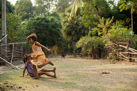 unicef: CHAMPASAK, LAOS - FEBRUARY 26 : Unidentified Children of Laos play and fun of kids in countryside village on FEBRUARY 26, 2011 in Champasak, Laos