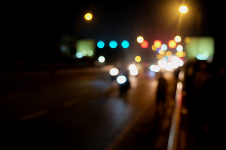 street lamp: Abstract Car traffic at night. Motion blurred. Which urban city beautiful background. Stock Photo