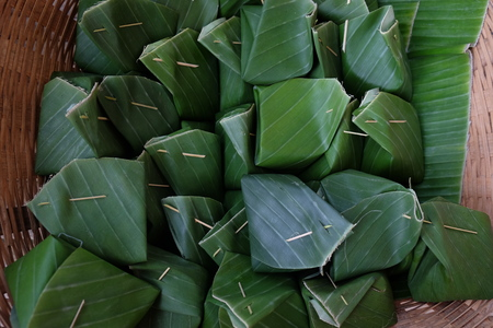 Sticky rice Thai custard is Thai dessert which wrap by banana leaf, within banana leaf is contain Sticky rice Thai custard Фото со стока
