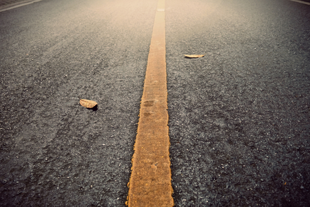 New asphalt texture with yellow line on road