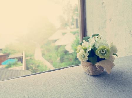 Bouquet decorate flowers in hay basket