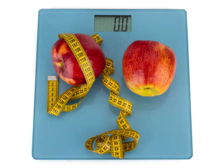 centimeter: Two red apples and yellow centimeter lie in the balance Stock Photo