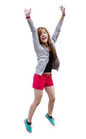 Asian women wear shorts, black shirts, gray robes and bright sneakers are jumping happily.