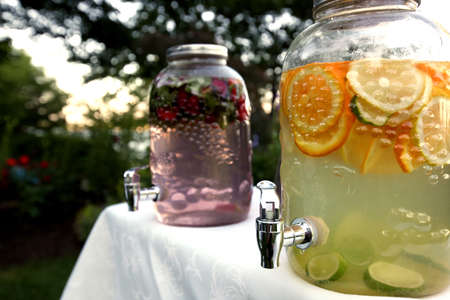 Lemonade and fruit drinks in glass despensing containers