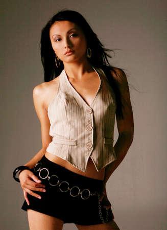 カジュアルなファッションで美しいアジア女性 写真素材