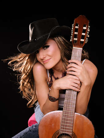 female singer: Beautiful Woman in Country Westren Fashion Holing A Guitar