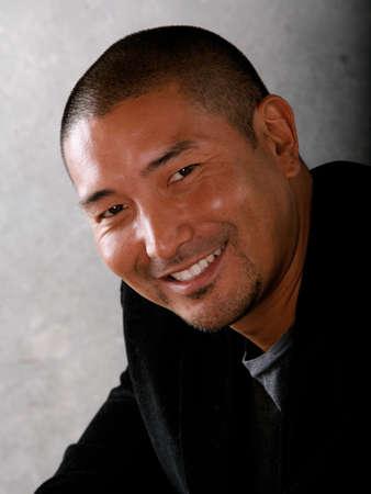 Attractive Smiling Asian Man Stock fotó
