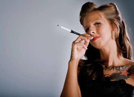 Beautiful Woman in Rockabilly Fashion & Smoking Stock Photo - 3271743
