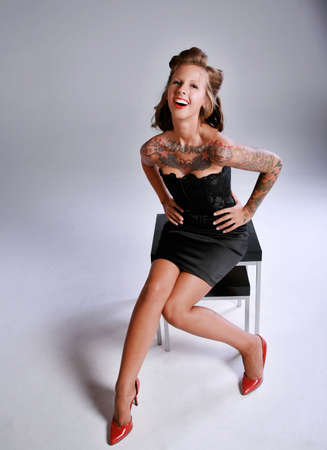 rockabilly: Rockabilly Girl in Pin up pose & Fashion Laughing Stock Photo