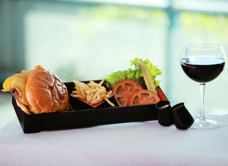 protien: Hamburger French Fries and a glass of red wine