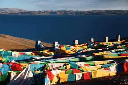 buddism: Tibet Lake Namtso and peaceful pray streamer