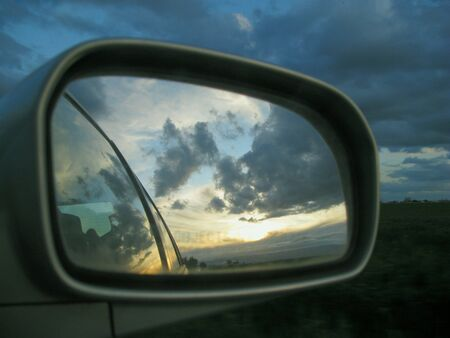 Sunset seen in rearview mirror