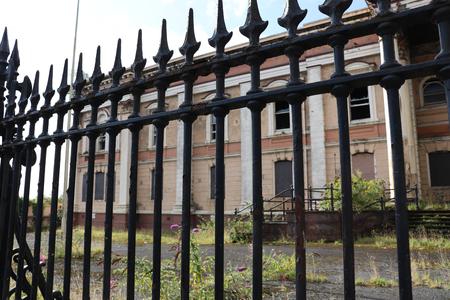 Courthouse behind fence Stock Photo