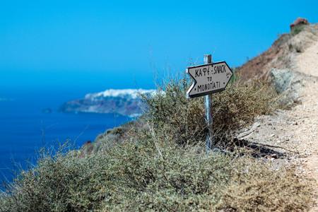 Sign along caldera, Oia, Santorini, Greece