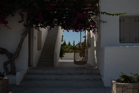 Hanging chair in walkway, Milos, Greece