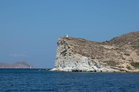 Lighthouse on cliff, Milos, Greece