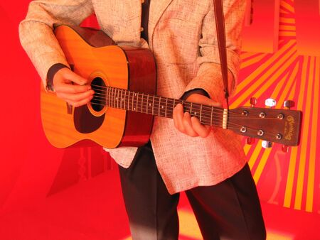auditory: guitar playing display in red background