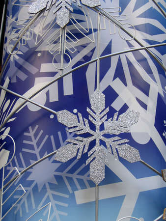 Shiny snowflake in blue background (vertical) photo