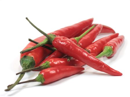 hottest: Red hot chili peppers in isolated background Stock Photo