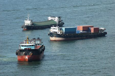 seafreight: Cargo ships parked in the habour