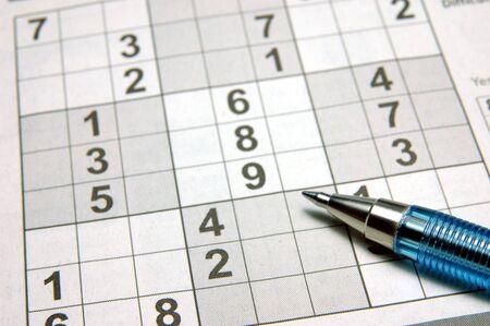 sudoku: Close up of a sudoku puzzle & pen