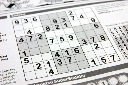 clues: Close up of a sudoku puzzle on newspaper Stock Photo