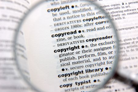 emphasized: Definition of copyright emphasized by a magnifying glass