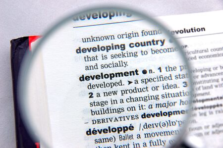 emphasized: Definition of development emphasized by a magnifying glass