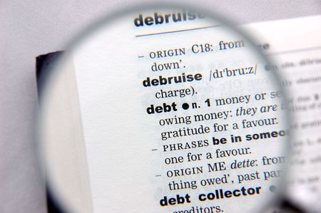 emphasized: Definition of debt emphasized by a magnifying glass Stock Photo
