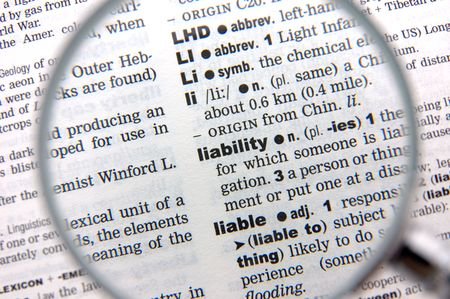emphasized: Definition of liability emphasized by a magnifying glass