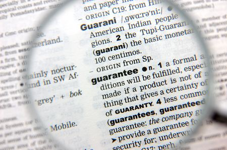emphasized: Definition of guarantee emphasized by a magnifying glass