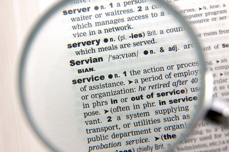 emphasized: Definition of service emphasized by a magnifying glass Stock Photo